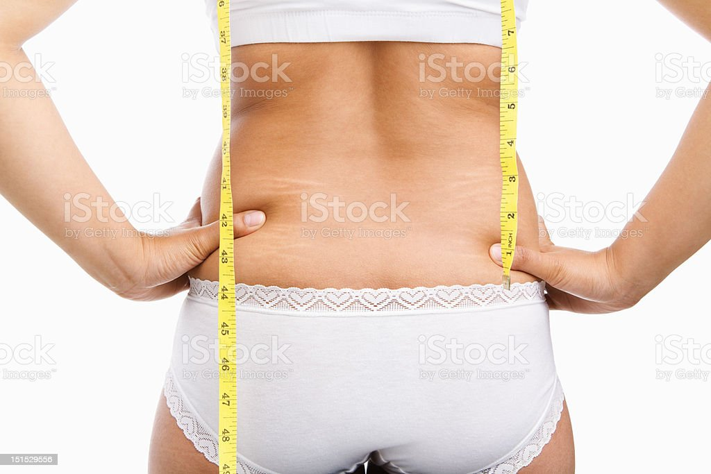 Woman back with cellulite and mesuring tape royalty-free stock photo