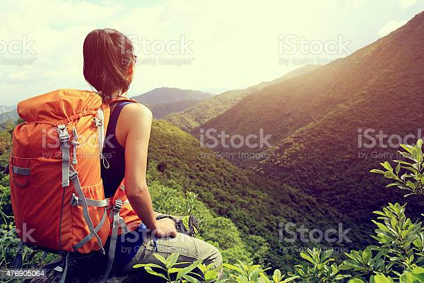 Woman Backpacker Enjoy The View At Mountain Peak Cliff Stock Photo - Download Image Now