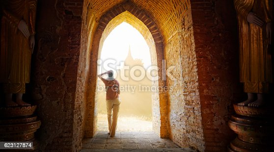 istock woman backpacker looking on sunset and enjoy the view  temples 623127874