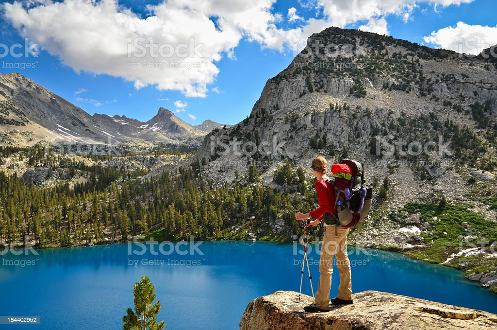 Woman backpacking in the mountains stock photo