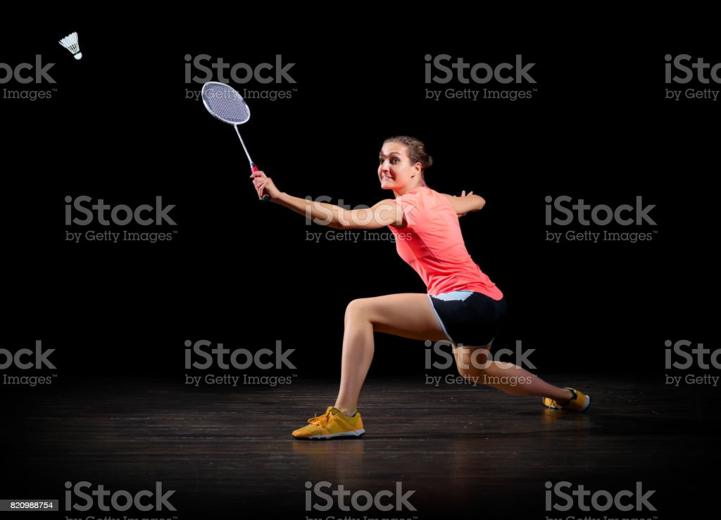 Woman badminton player (on black version) stock photo