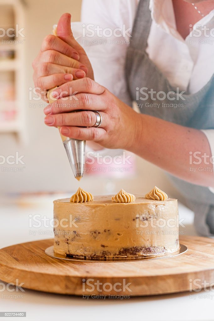 woman baking a cake stock photo