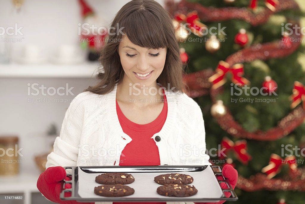 Woman baking cookies for christmas. royalty-free stock photo