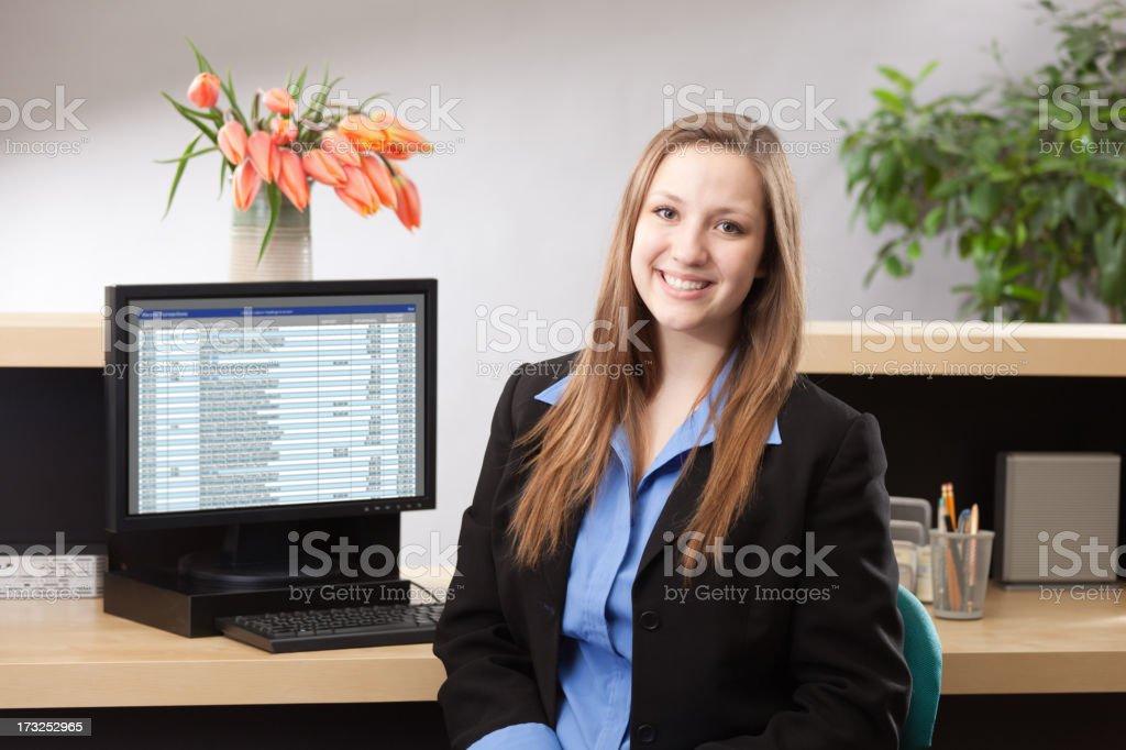 Woman Bank Teller at Retail Banking Counter Providing Financial Service stock photo