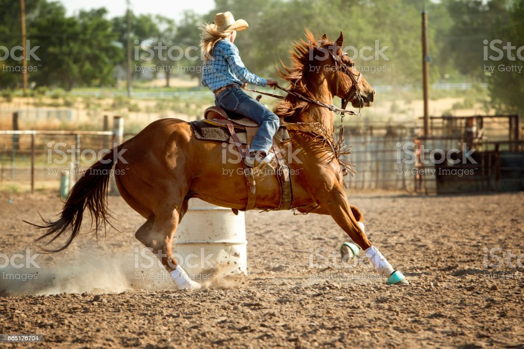Woman Barrel Racing On Her Beautiful Horse In A Rodeo Arena Stock Photo Download Image Now Istock