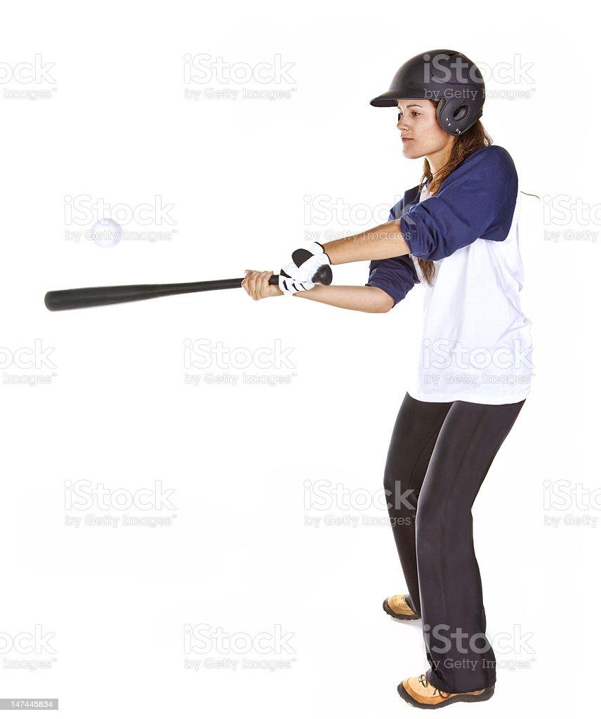 Woman Baseball or Softball Player Hits a Ball stock photo