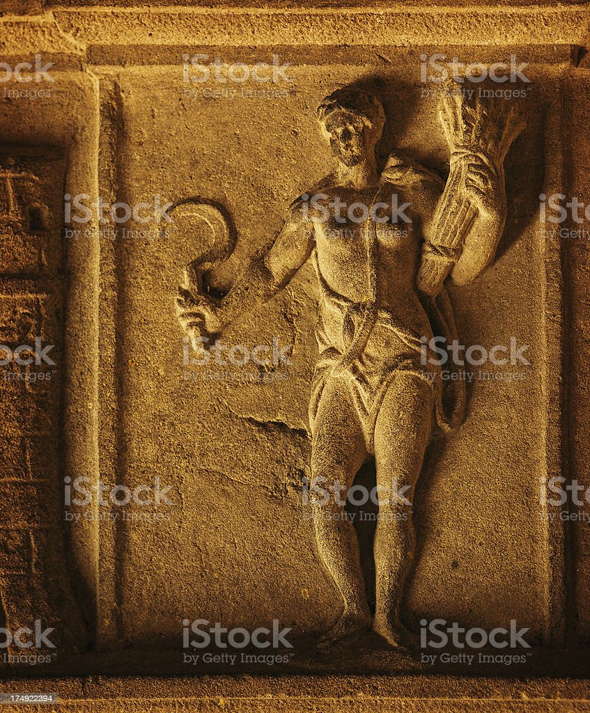 woman bass-relief with sickle stock photo