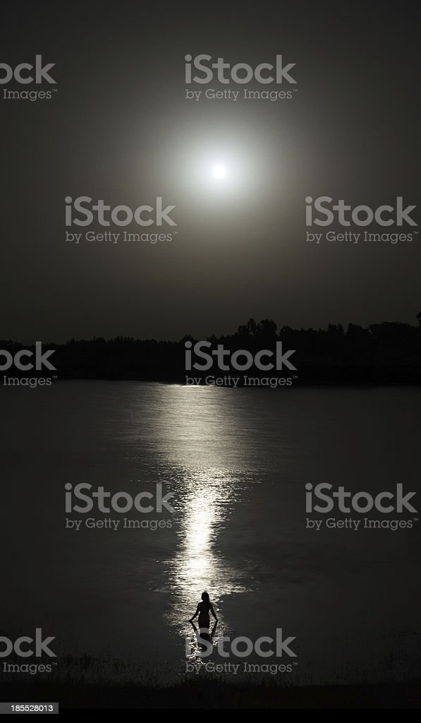 Woman bathing in moonlight royalty-free stock photo