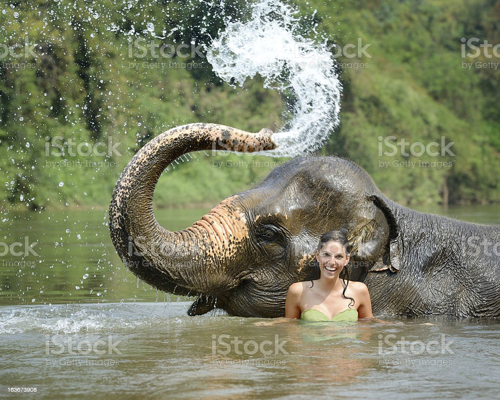 Woman bathing with an Elephant, Tropical Rain Forest royalty-free stock photo