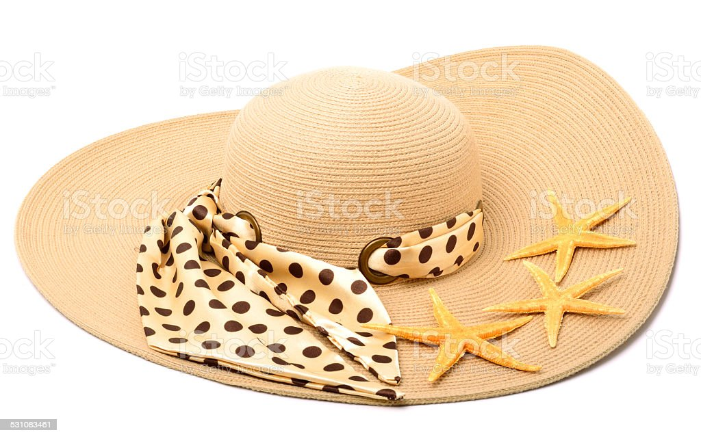 Woman beach hat with starfishes stock photo