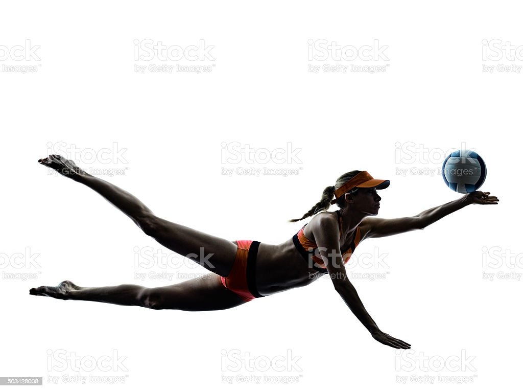 woman beach volley ball player silhouette stock photo