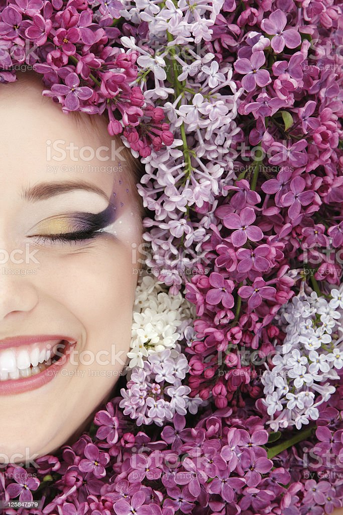 woman beautiful face with flower lilac frame royalty-free stock photo