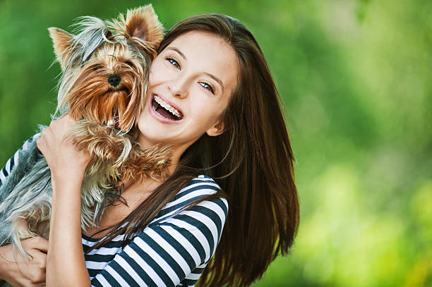 woman beautiful young holds small dog stock photo