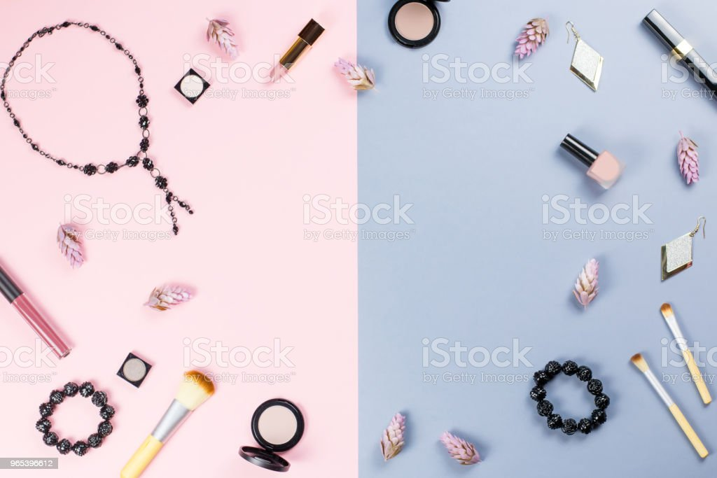 woman beauty accessories flat lay on pastel background. Fashion or beauty blogger concept. royalty-free stock photo