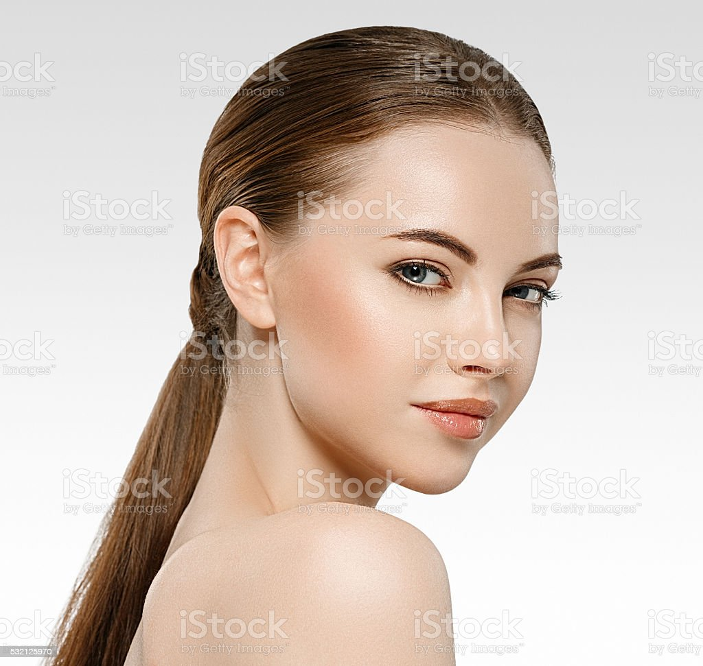 Woman beauty face portrait isolated on white with healthy skin stock photo