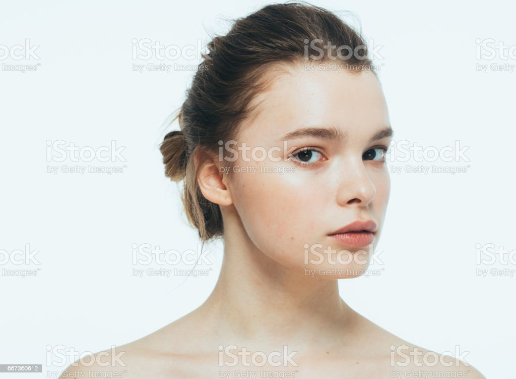 Woman beauty face with hand portrait isolated on white with healthy skin. Studio shot. stock photo