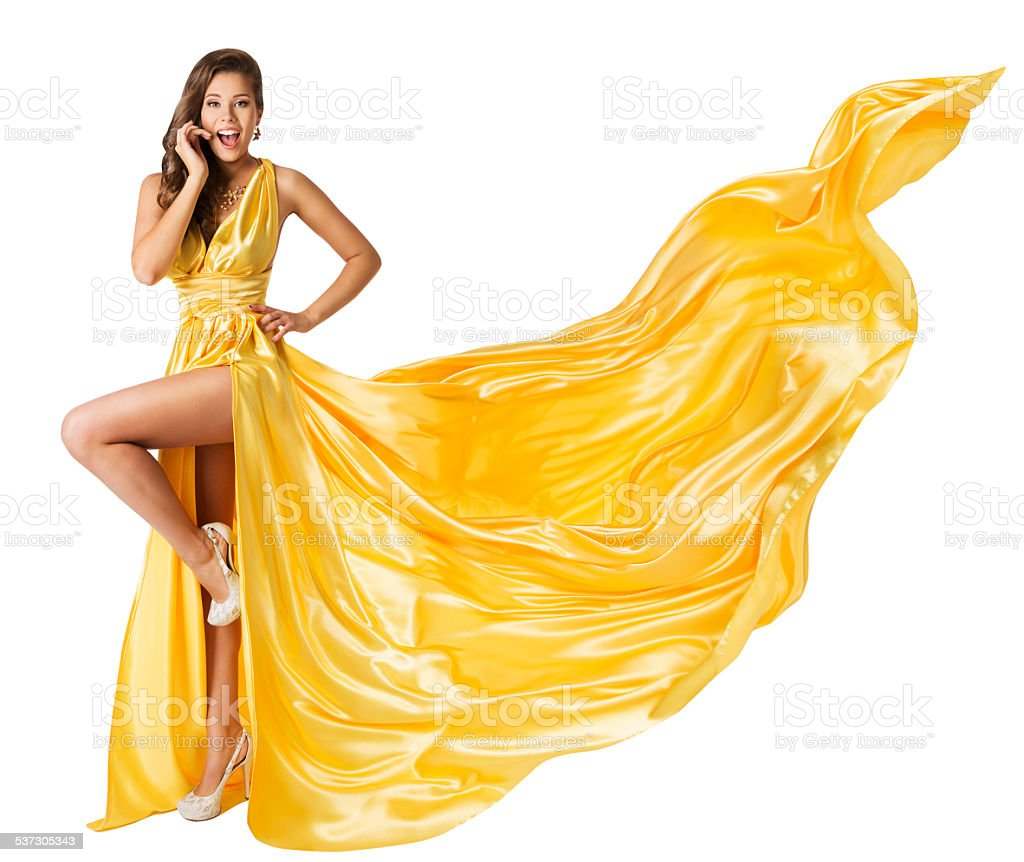 Woman Beauty Fashion Dress, Girl In Flying Yellow Fluttering Gown stock photo