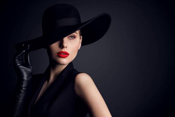 Woman Beauty in Hat, Elegant Fashion Model Retro Style Portrait on Black stock photo