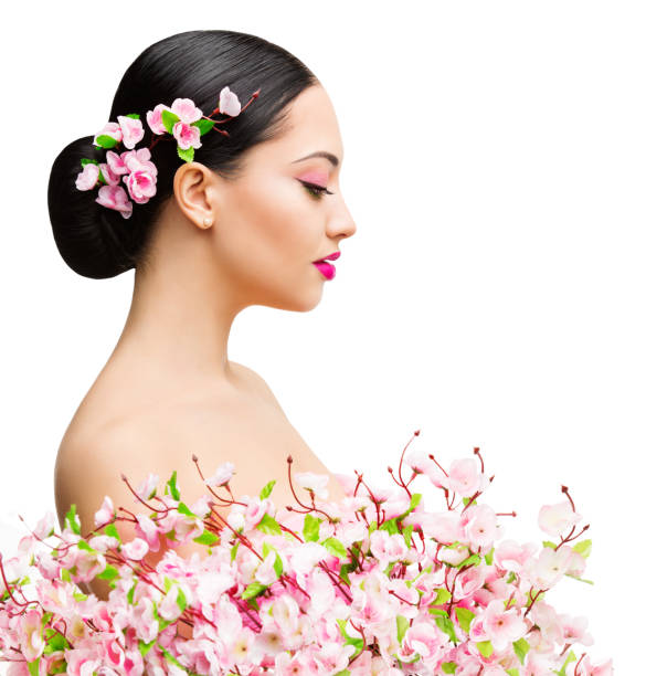 Woman Beauty in Sakura Flowers, Beautiful Asian Girl Spring Fashion Portrait on White stock photo
