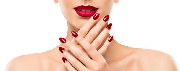 Woman Beauty Lips Nails, Beautiful Model Face Lipstick Makeup, Red Manicure Polish stock photo