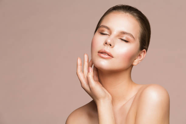 Woman Beauty Portrait, Beautiful Model Touching Neck by Hand, Girl Skin Care and Treatment stock photo