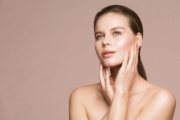 Woman Beauty Portrait, Model Touching Face, Beautiful Girl Makeup and Nails Treatment stock photo