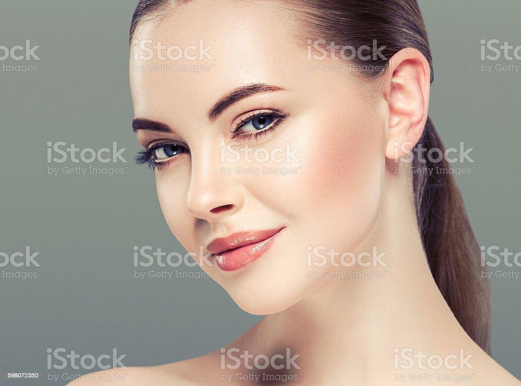 Woman beauty portrait skin care concept. blue background stock photo