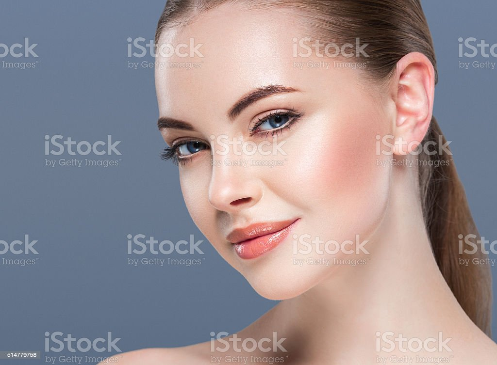 Woman beauty portrait skin care concept on blue background. stock photo