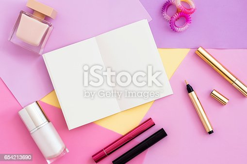 istock Woman beauty products and blank notepad top view. 654213690