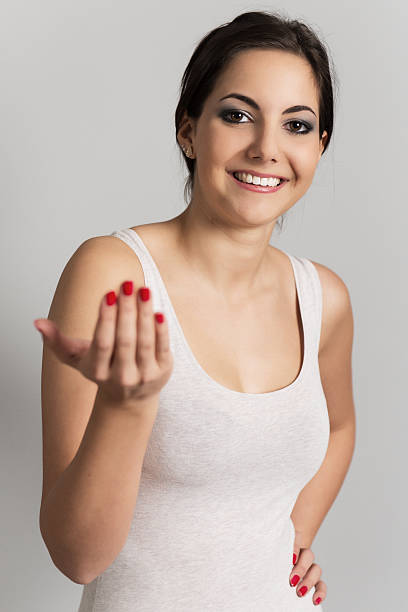 Woman beckoning to the viewer stock photo