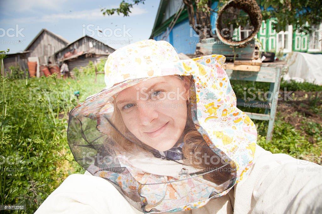 woman beekeeper making selfie near beehives apiary stock photo