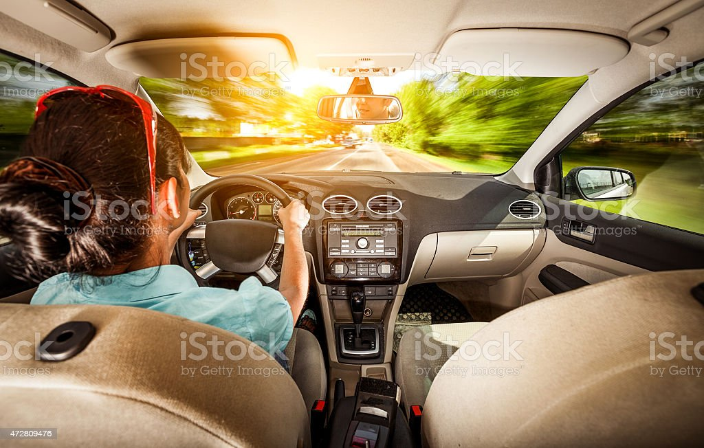 Woman behind the wheel of a car. stock photo