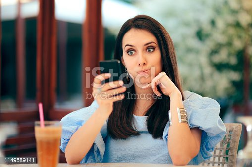 992209122istockphoto Woman Being Amused Trying to Find a Date Online 1149589141