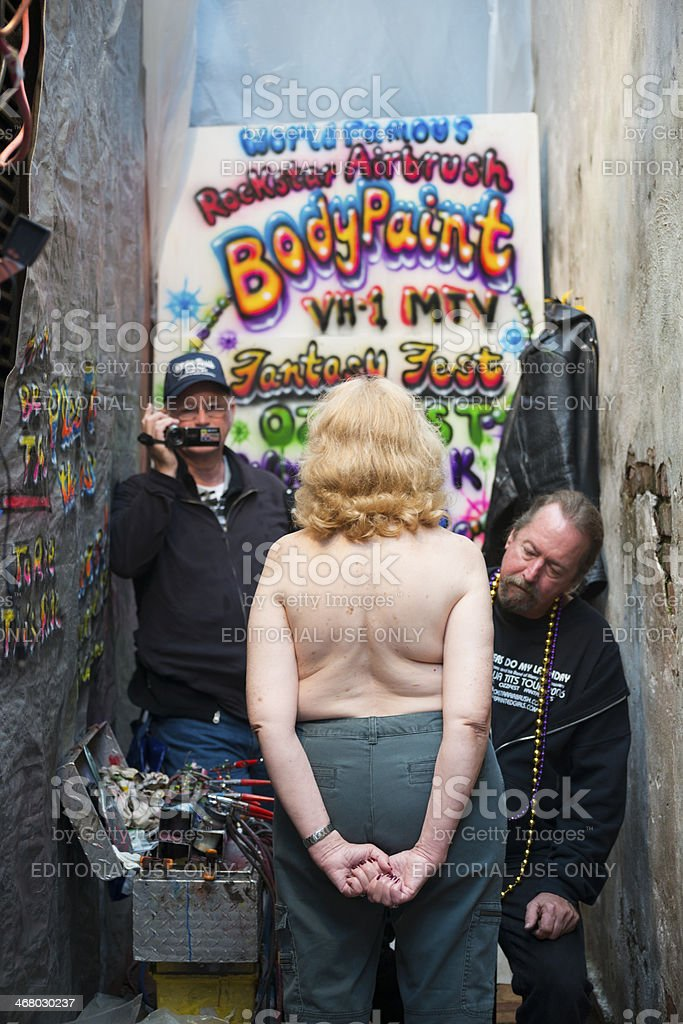 Woman Being Bodypainted During Mardi Gras Celebrations In New