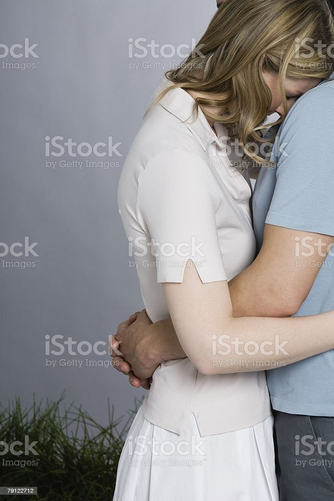 Woman being consoled  Adult Stock Photo