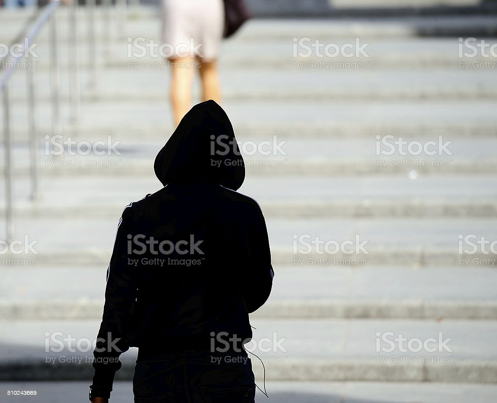 Woman being followed stock photo
