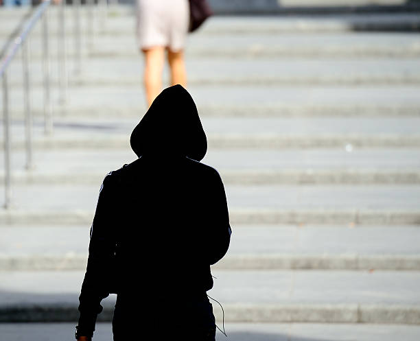woman being followed - stalking stock photos and pictures