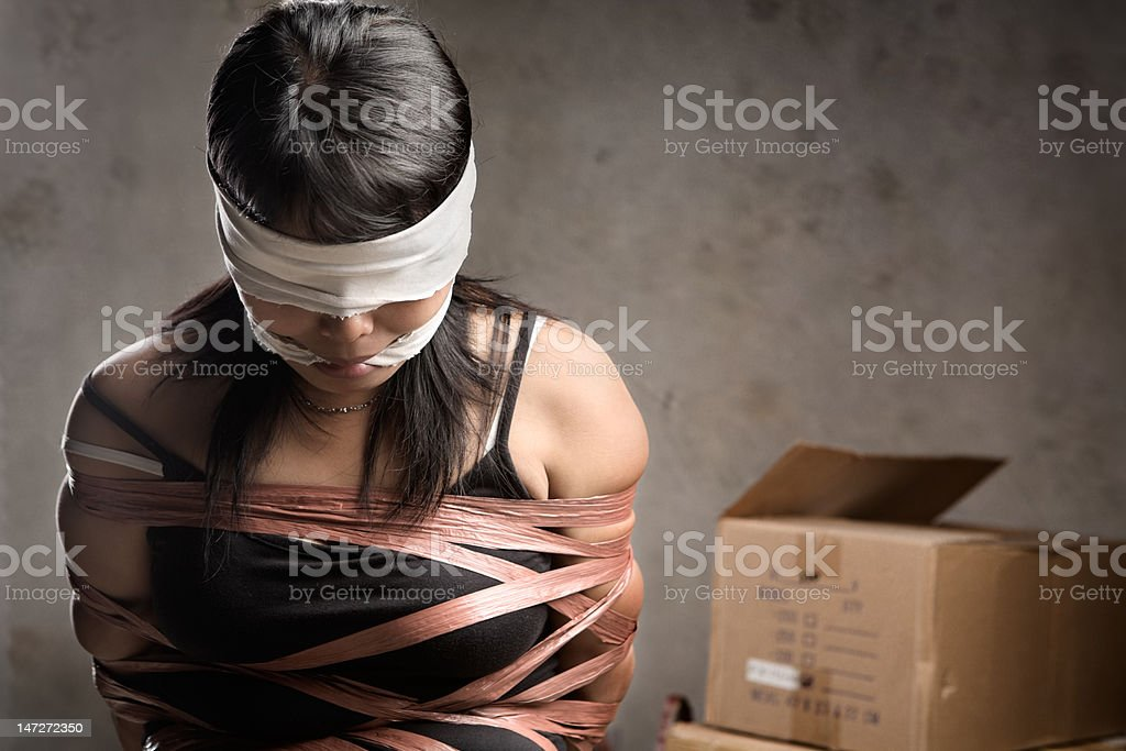 Woman being kidnapped stock photo