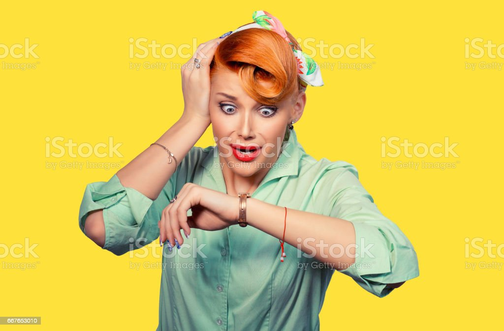 Woman being late. Closeup portrait headshot view stressed young attractive beautiful businesswoman checking the time being late to a business meeting to a rendez-vous, date isolated yellow background stock photo