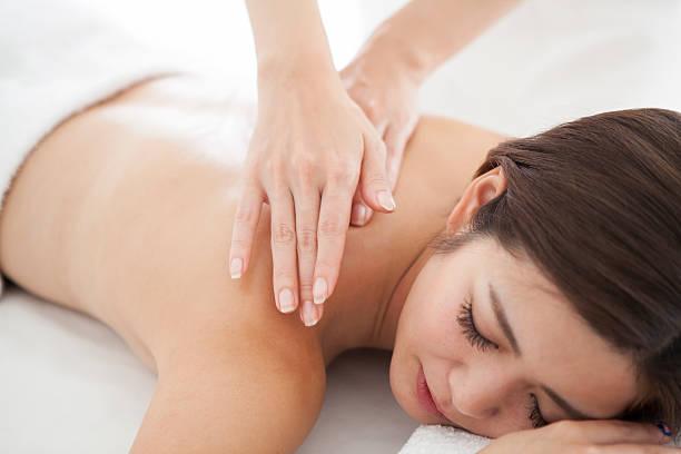 woman being massaged by an esthetic salon - エステ ストックフォトと画像