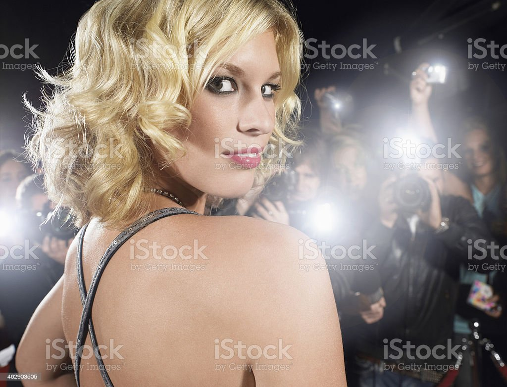 Woman Being Photographed By Paparazzi stock photo