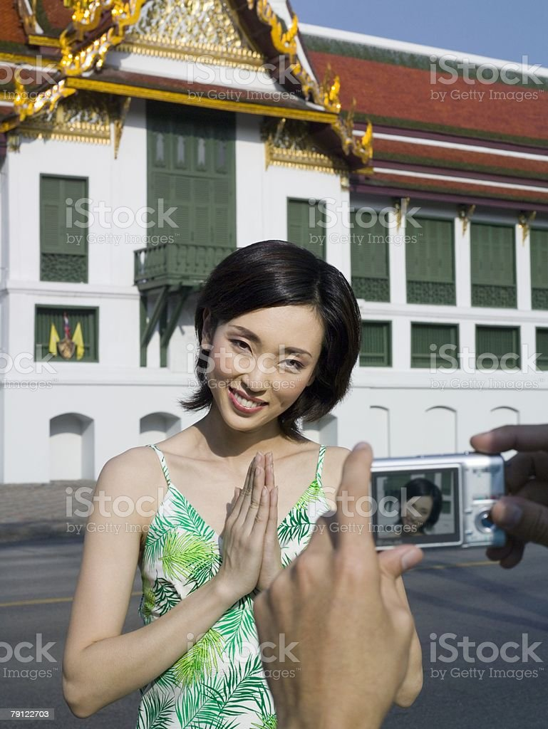 Woman being photographed outside building 免版稅 stock photo
