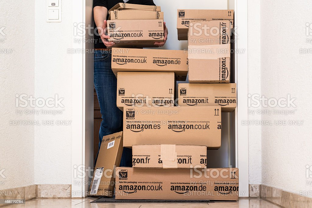 Woman being shocked by Amazon.com delivery stock photo