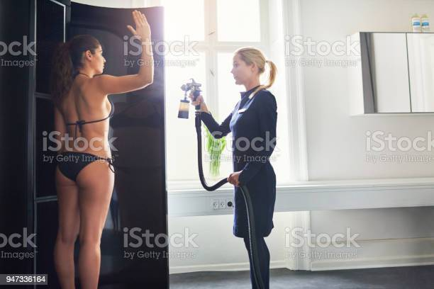 Woman being sprayed with bodypaint during spraytan session picture id947336164?b=1&k=6&m=947336164&s=612x612&h= vxfrecapv8wv1jrqh1bnkvzmp6mjdfeh72orckvc0m=