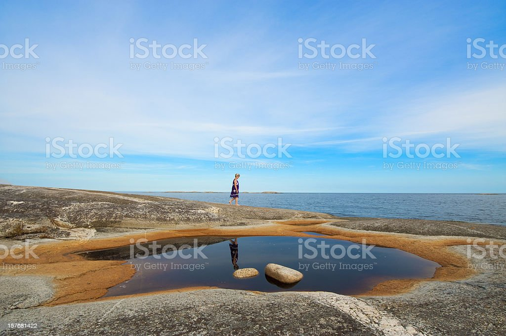 Woman between sea and sky stock photo