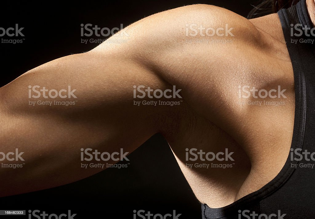 Woman biceps muscle royalty-free stock photo