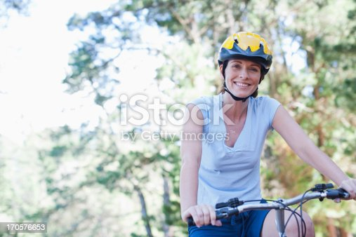 istock Woman bicycle riding in forest 170576653