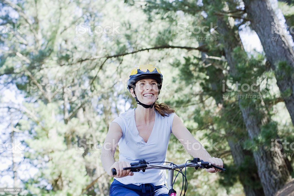 Woman bike riding in remote area royalty-free stock photo