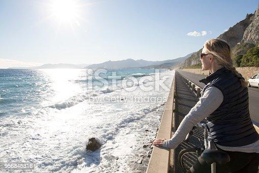 She looks off to distant scene, Liguria