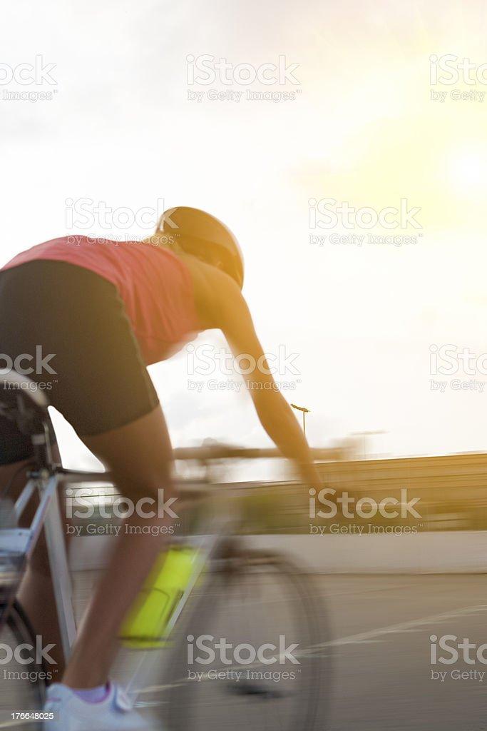 woman biking. blurred image bacause of panning royalty-free stock photo